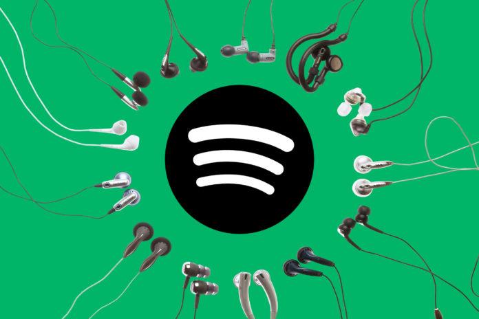 spotify headphones 696x464 - Топ самых прослушиваемых артистов на Spotify